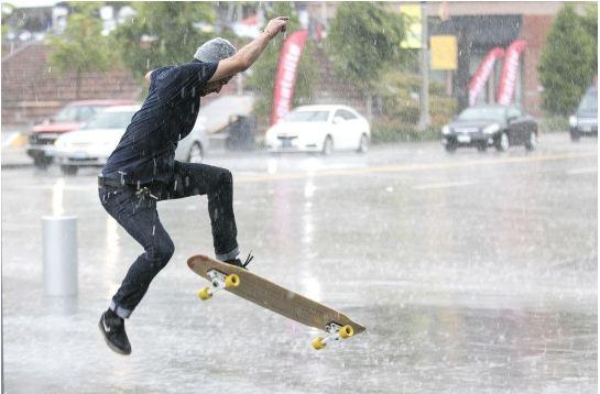 skateboarding in the rain